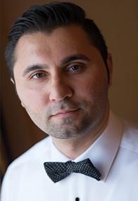 Samim Amini, Associate Director